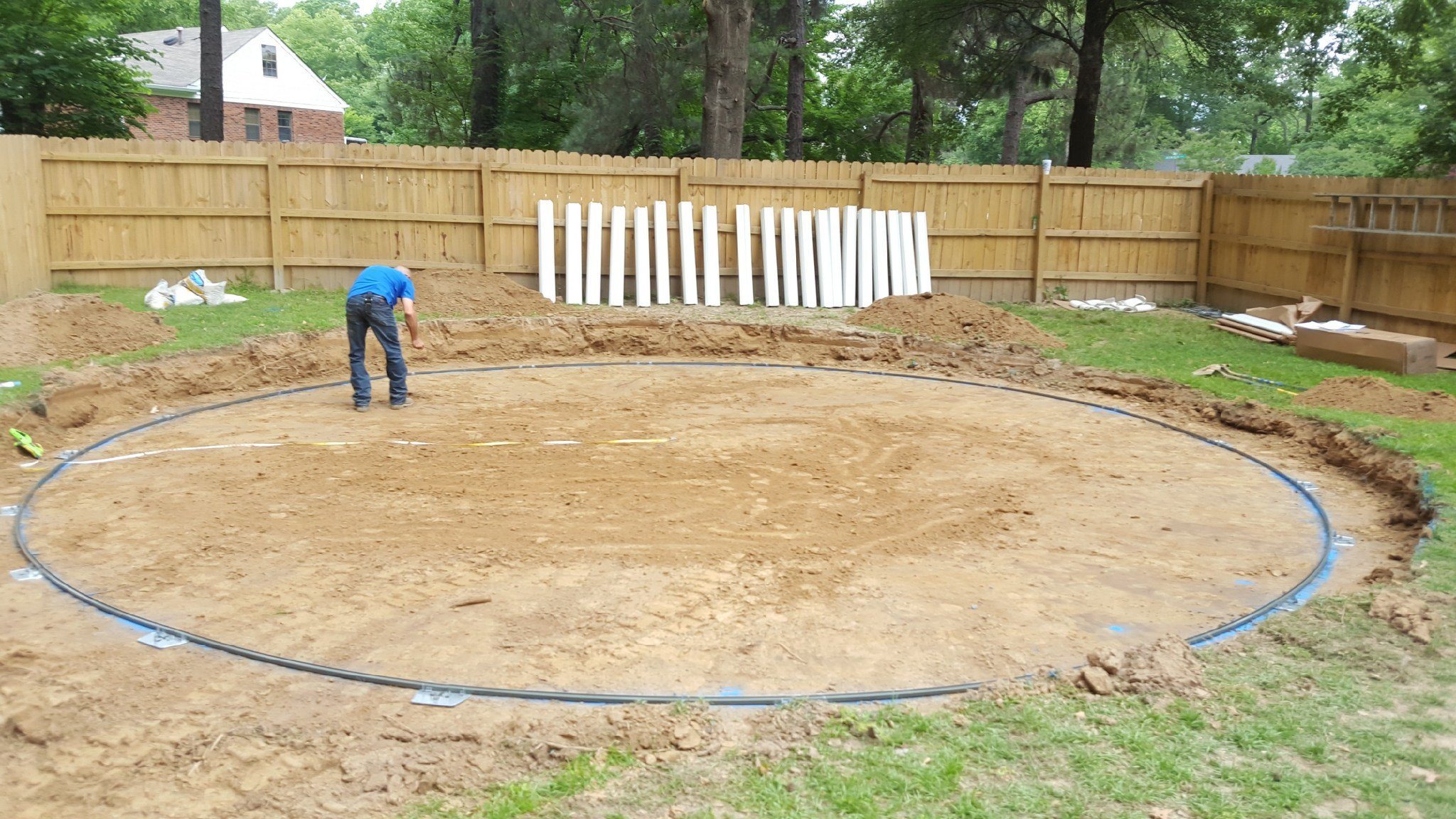 Installing an above ground swimming pool sand base