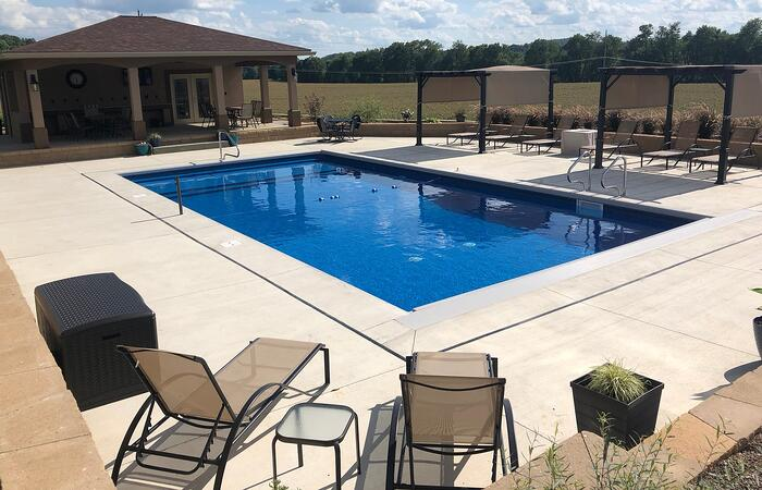 How Much Decking or Patio Do I Need Around an Inground Swimming Pool?