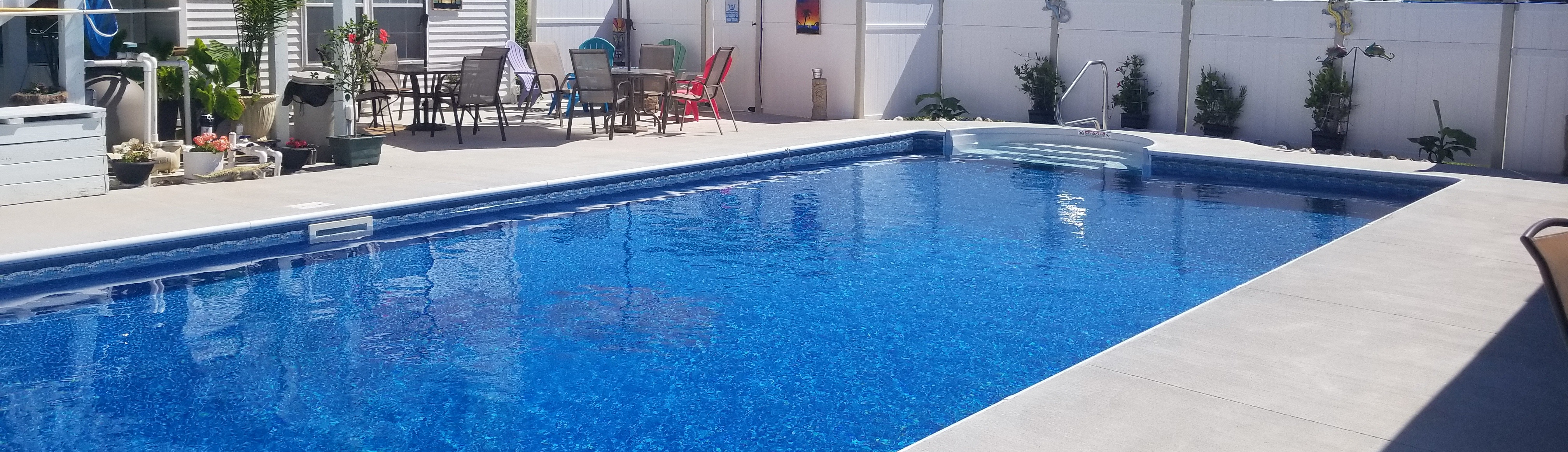 how can I help keep my swimming pool warmer